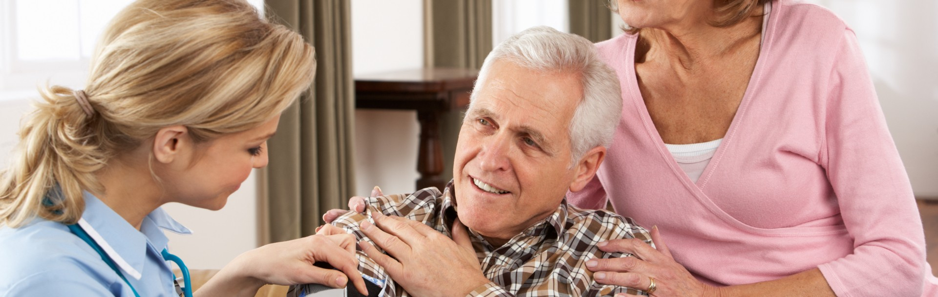 senior man looking at her young caregiver