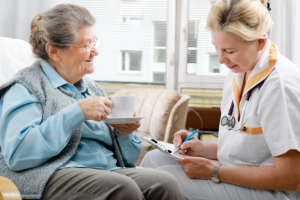 caregiver monitoring her patient's fluid intake