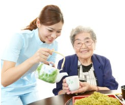 caregiver preparing food for her patient